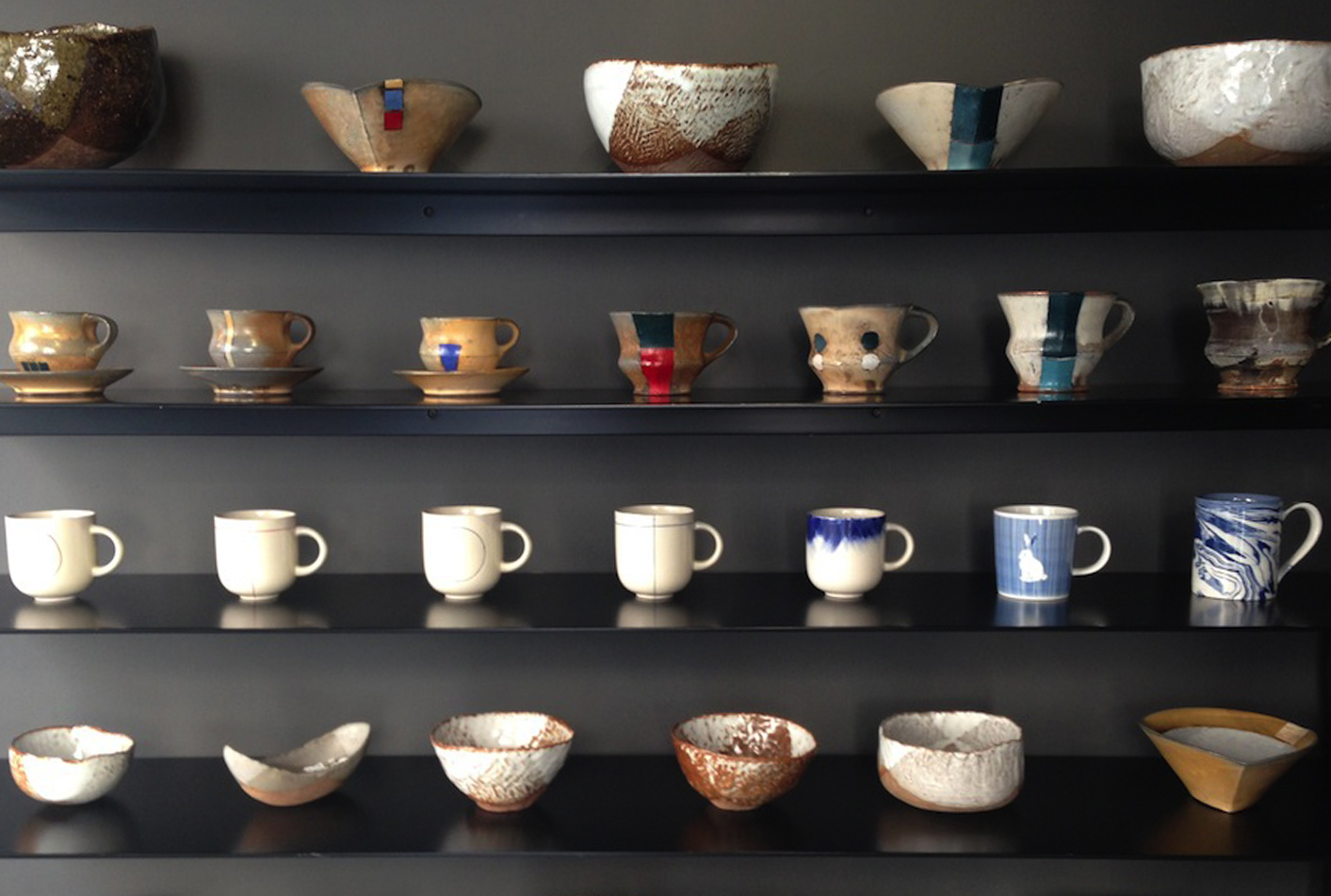 Shelves of ceramics at Everyday's good - Zolima CityMag